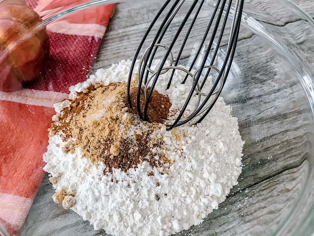 Whisk together the flour, baking powder, baking soda, cinnamon, nutmeg, ginger, and salt in a large mixing bowl.