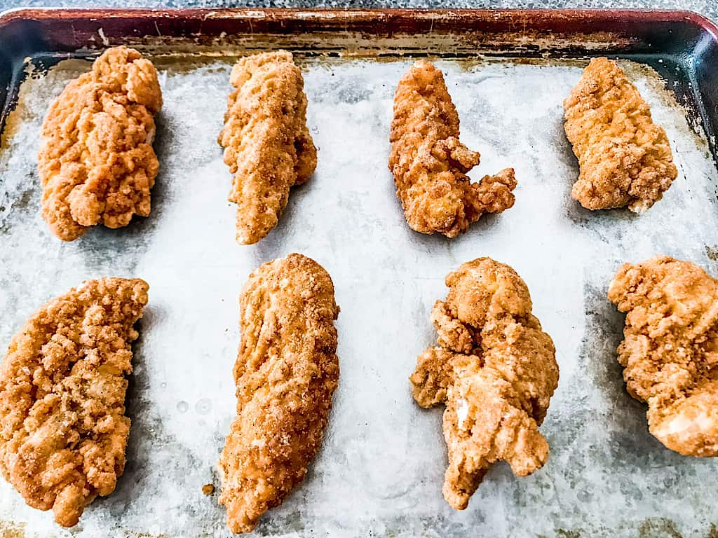 Heat the frozen chicken tenders according to package directions or prepare 1 recipe of Oven Fried Chicken Tenders.
