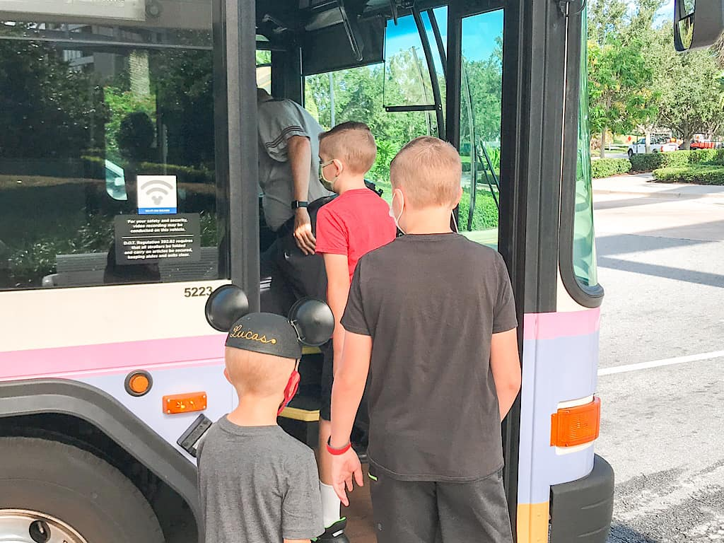 A family getting on a Disney World Transportation Bus at Contemporary Resort