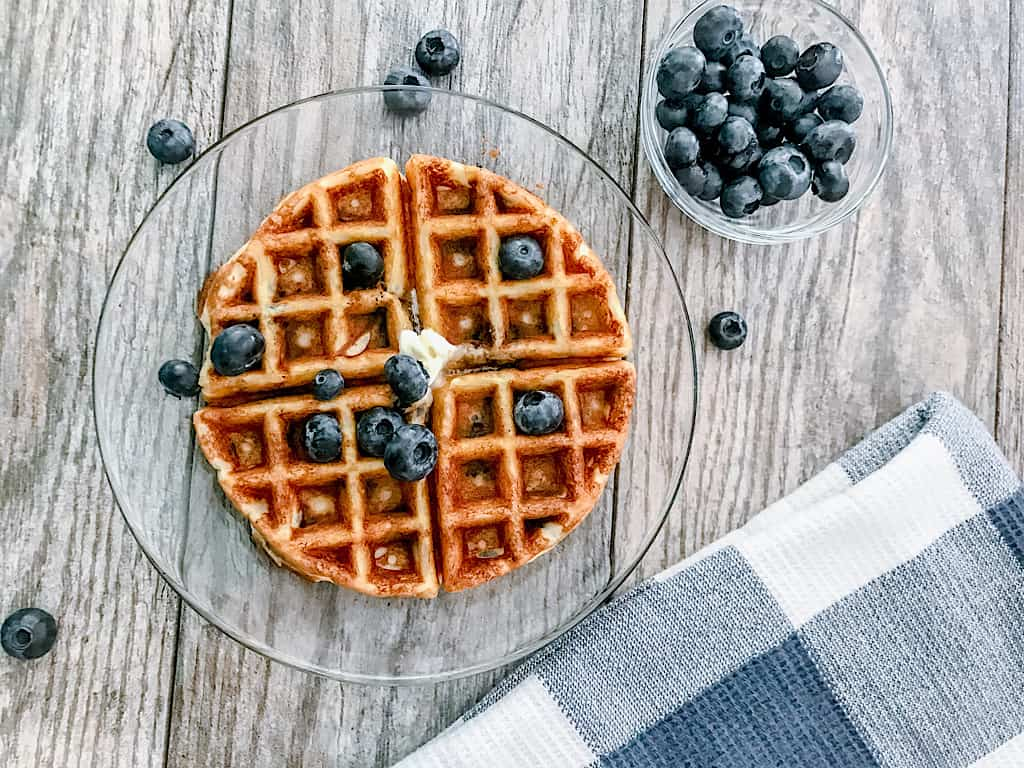 A low carb waffle with a side of blueberries