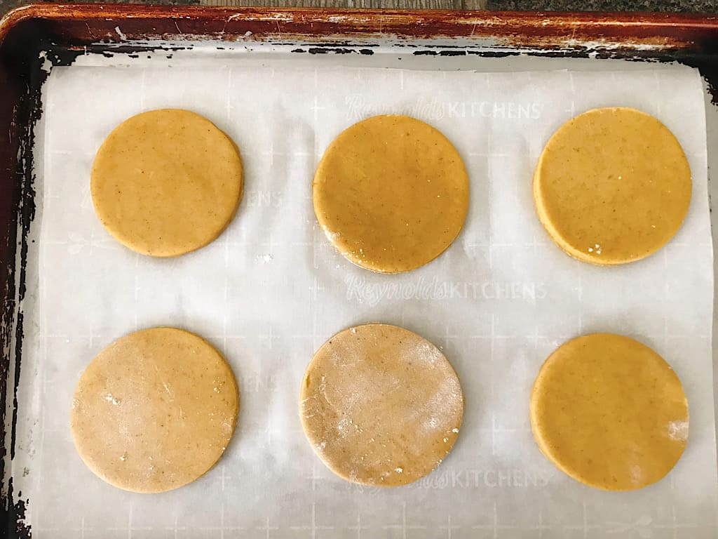 Sugar Cookie dough cut outs on a baking sheet
