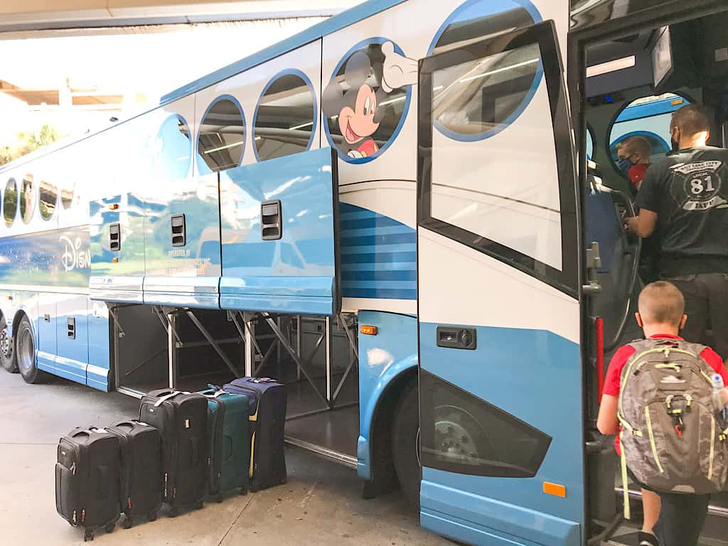 A child getting on Disney's Magical Express Bus on the way to Contemporary Resort