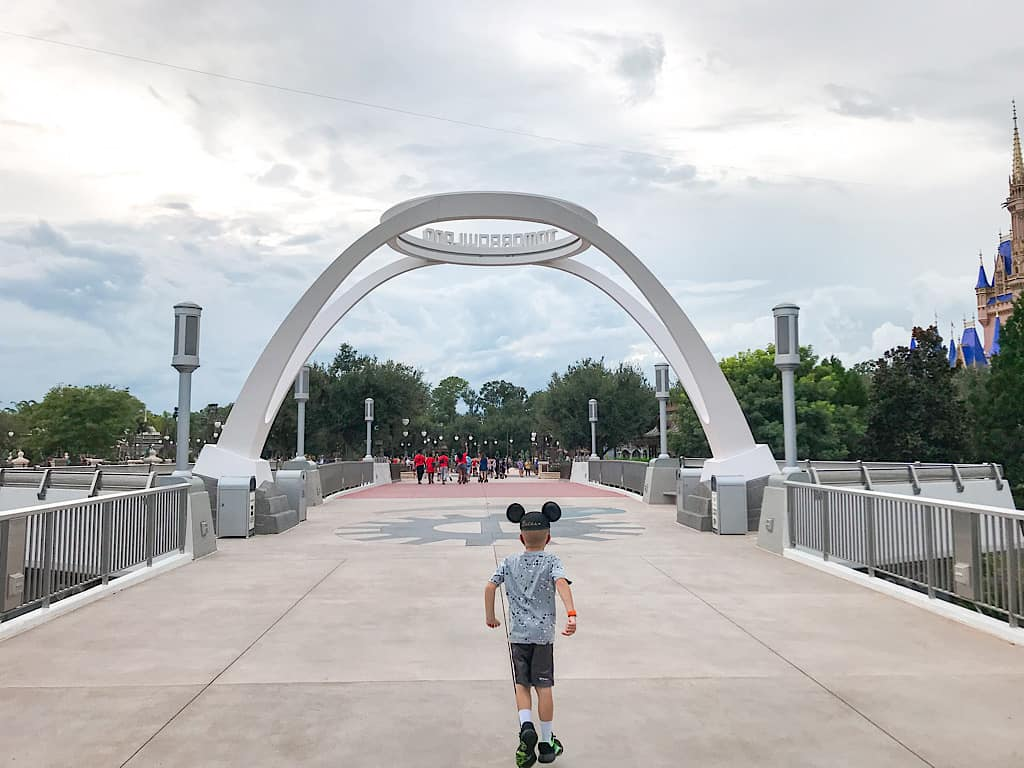 A child with Mickey Ears near the entrance of Tomorrowland at Disney's Magic Kingdom Park
