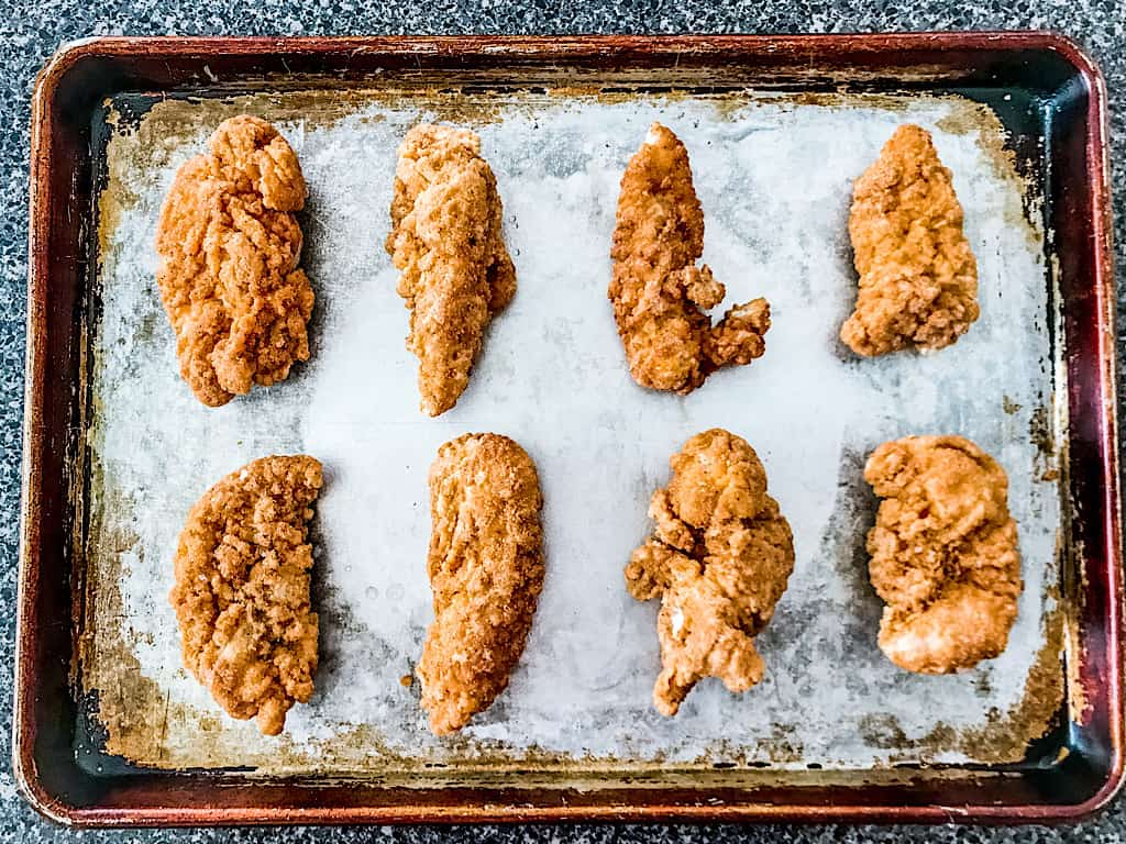 Chicken tenders on a baking sheet