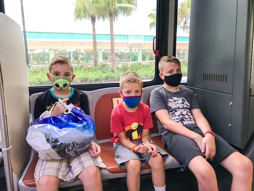 Kids riding Disney Transportation bus