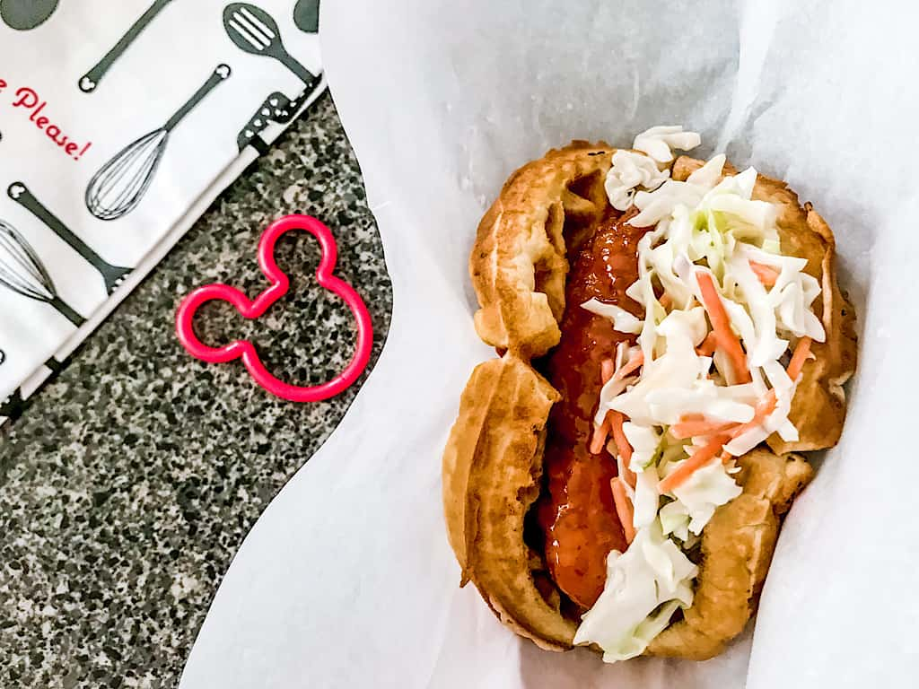 A waffle sandwich with sweet & spicy chicken and cole slaw