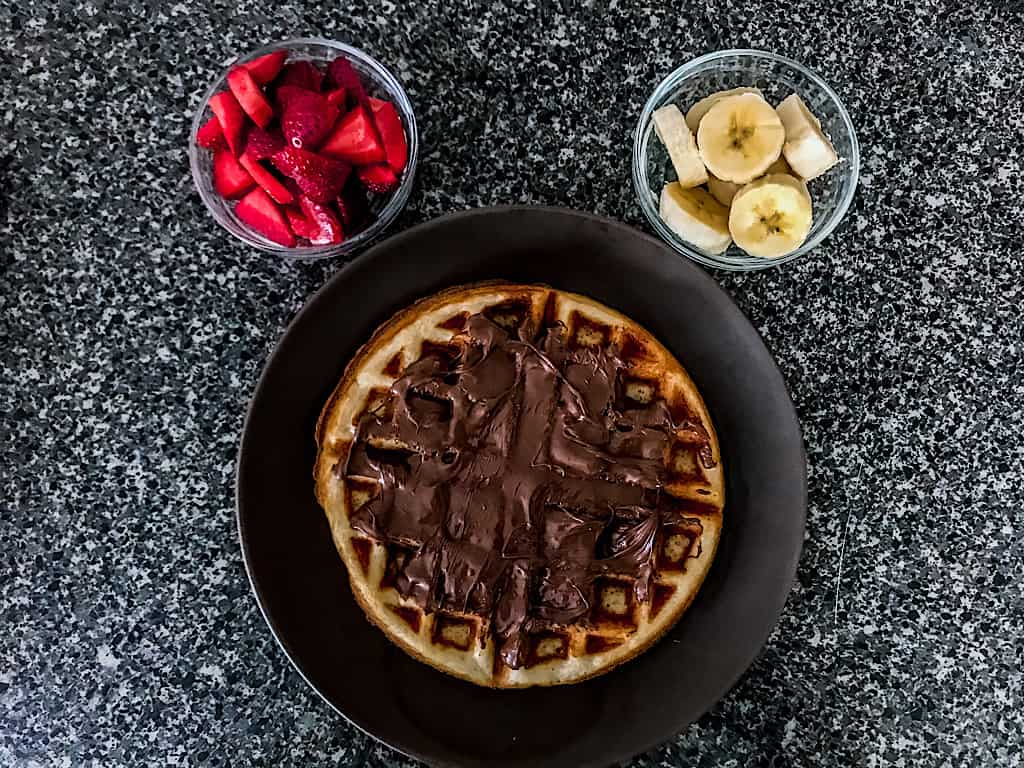 A Disney Waffle with Nutella and strawberries and bananas.