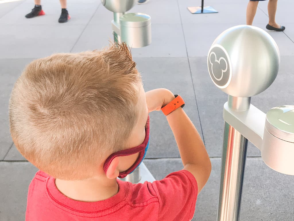A boy scanning a magic band at Disney World