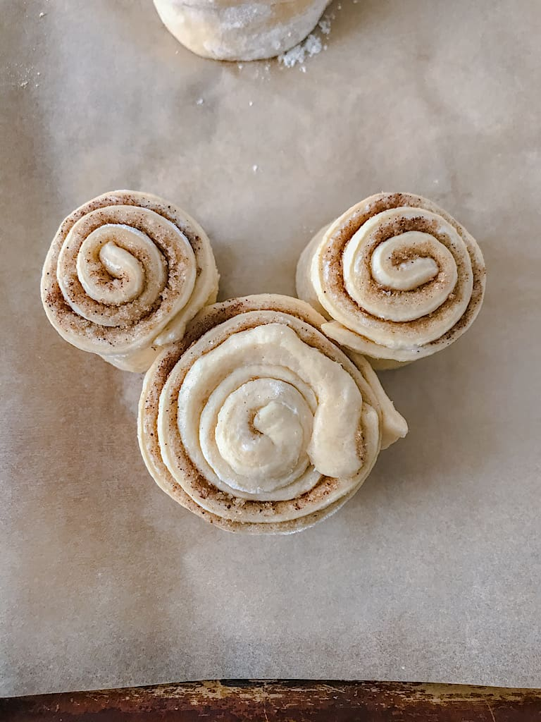 An unbaked Mickey Mouse Cinnamon Roll