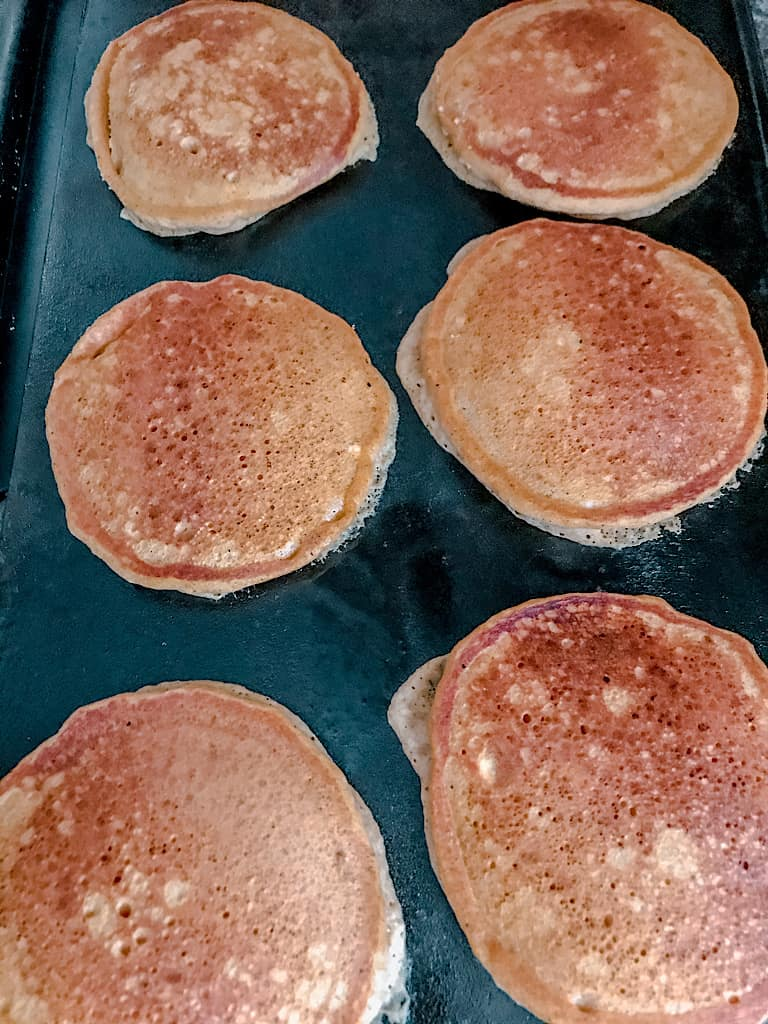 When the pancakes begin to bubble, flip them over and cook the other side for 2-3 minutes.