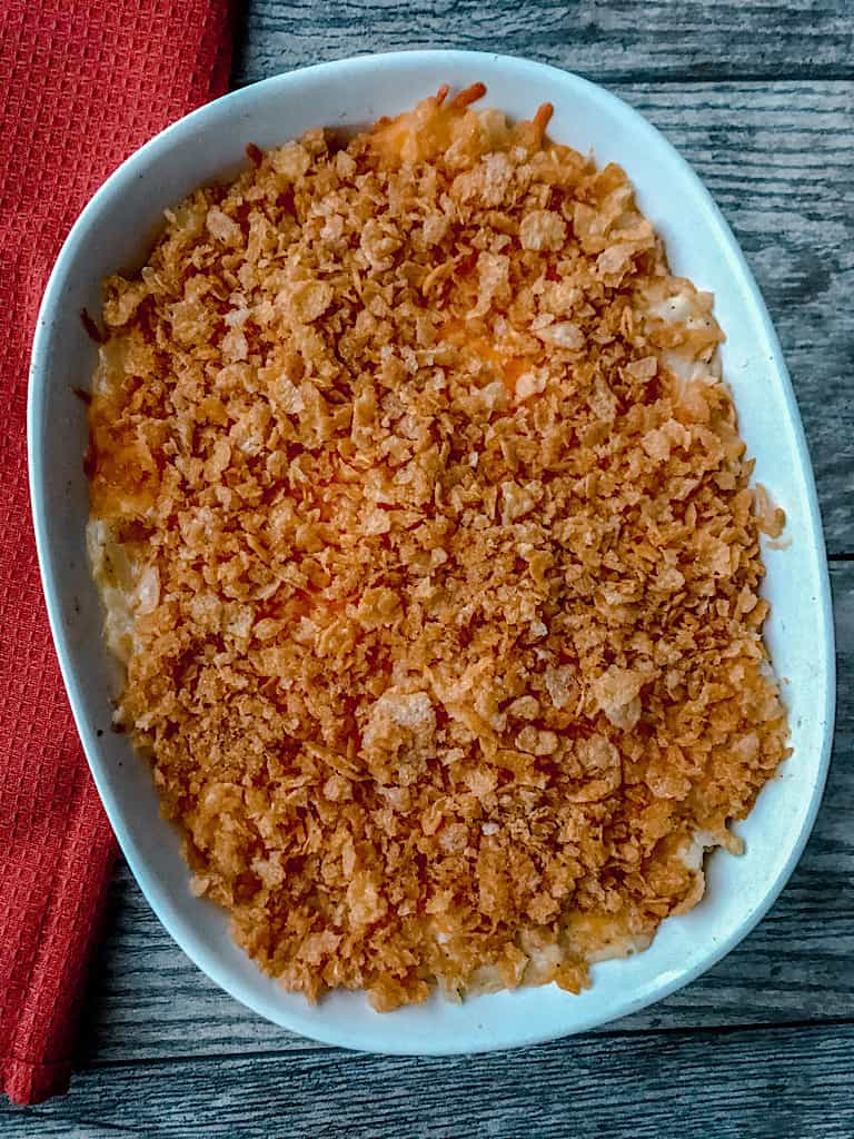 A pan of three cheese funeral potatoes with cornflakes
