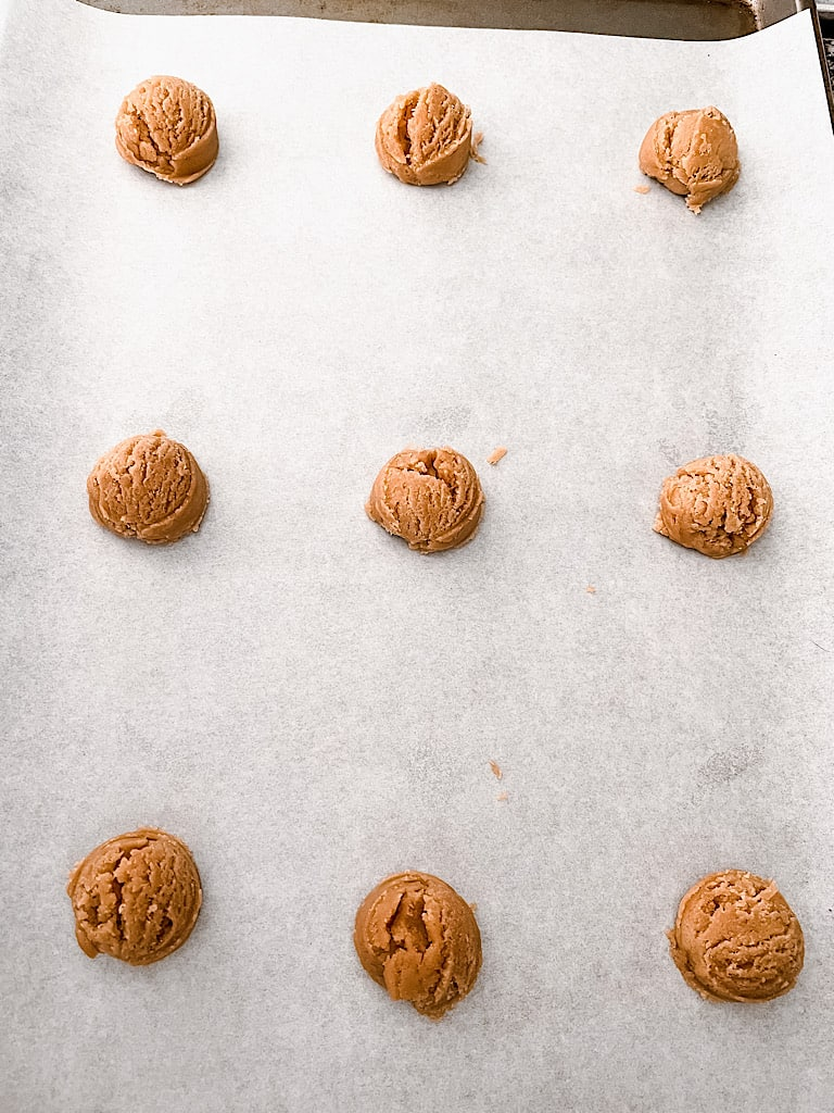 Drop Cookies: Use a cookie scoop to drop cookie dough balls onto a baking sheet lined with parchment paper about 2 inches apart.