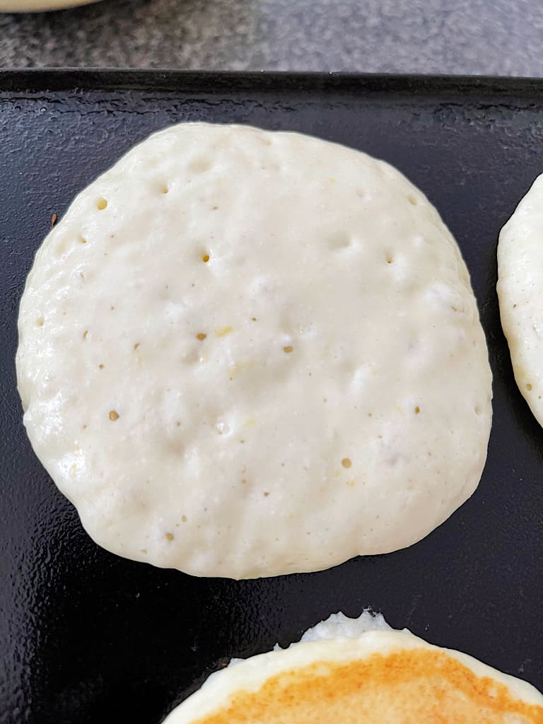 When bubbles begin to appear on the pancakes, flip them over and cook on the other side for 2-3 minutes.