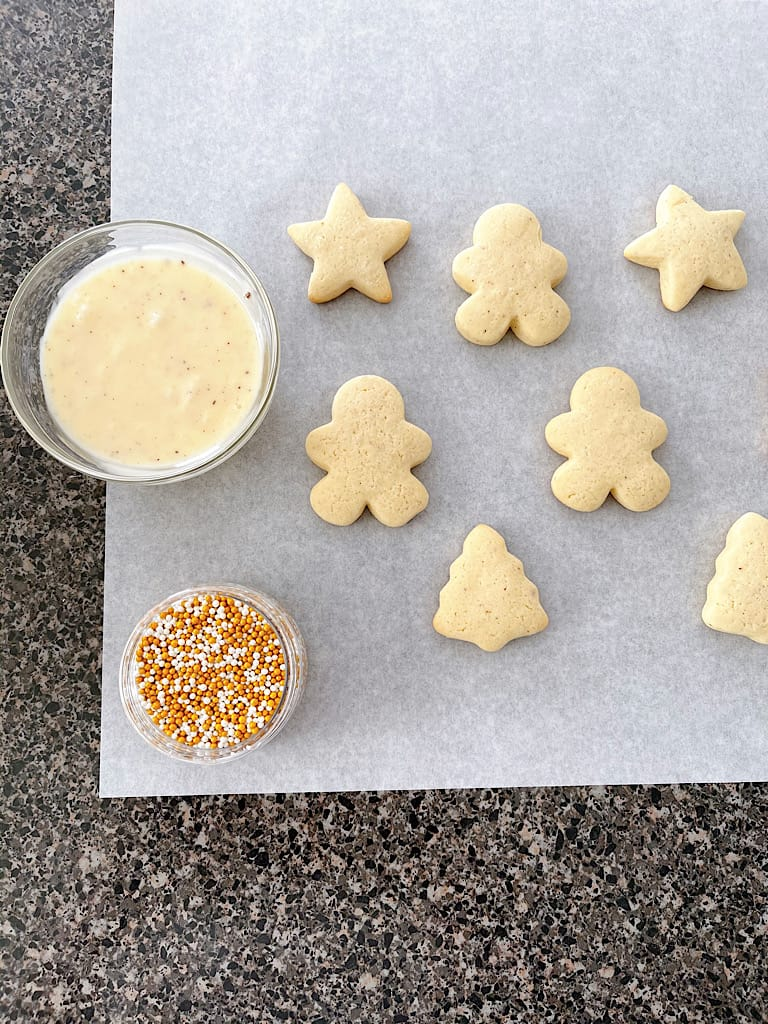 Eggnog icing, sprinkles, and eggnog sugar cookies