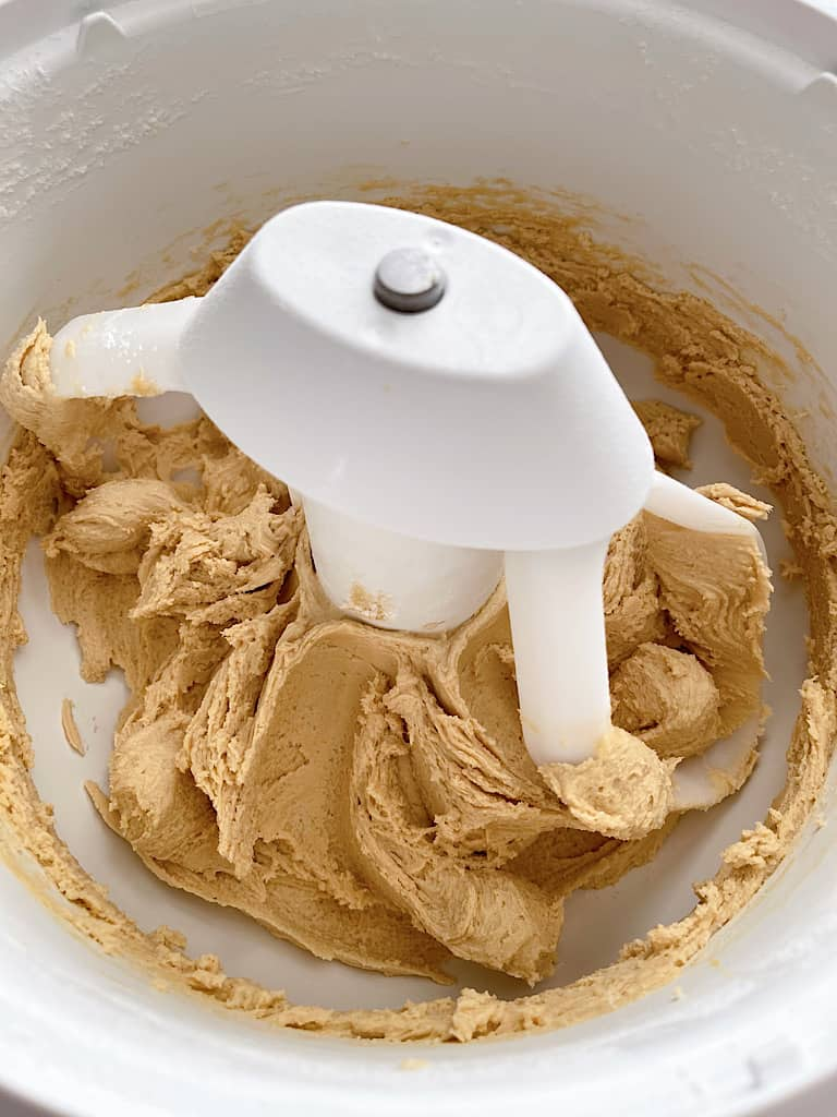 Add the flour, cornstarch, baking soda, and salt and mix for about 1 minute, until cookie dough begins to form.