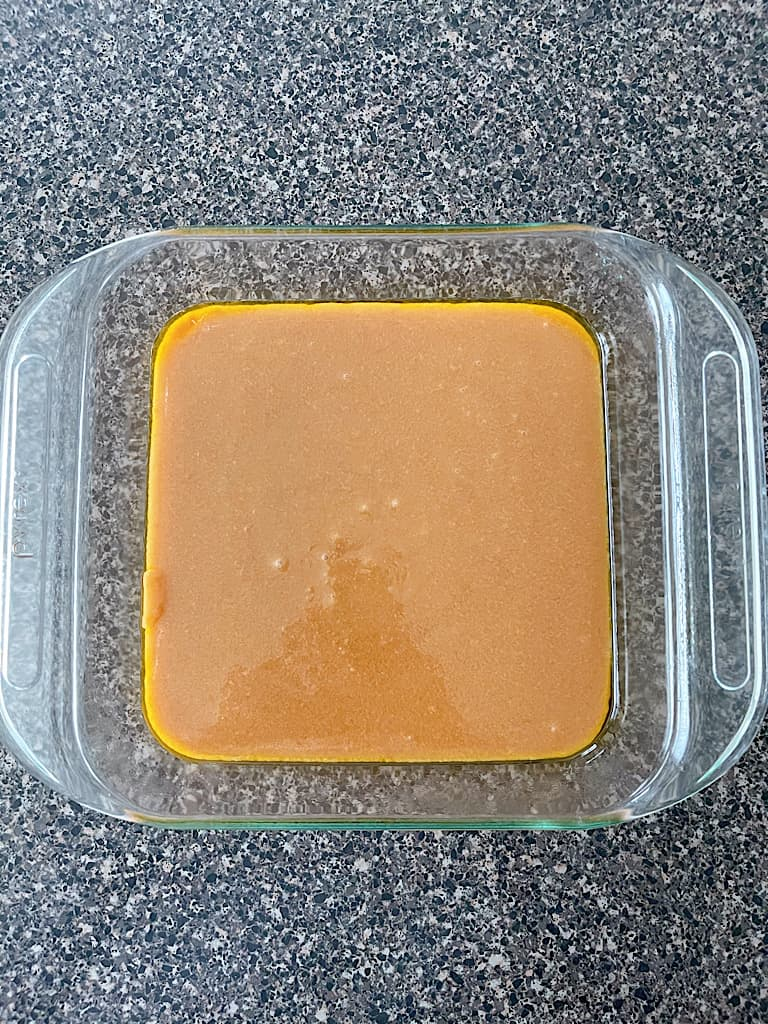 Pour the heated mixture into a generously greased 9x9 glass dish.