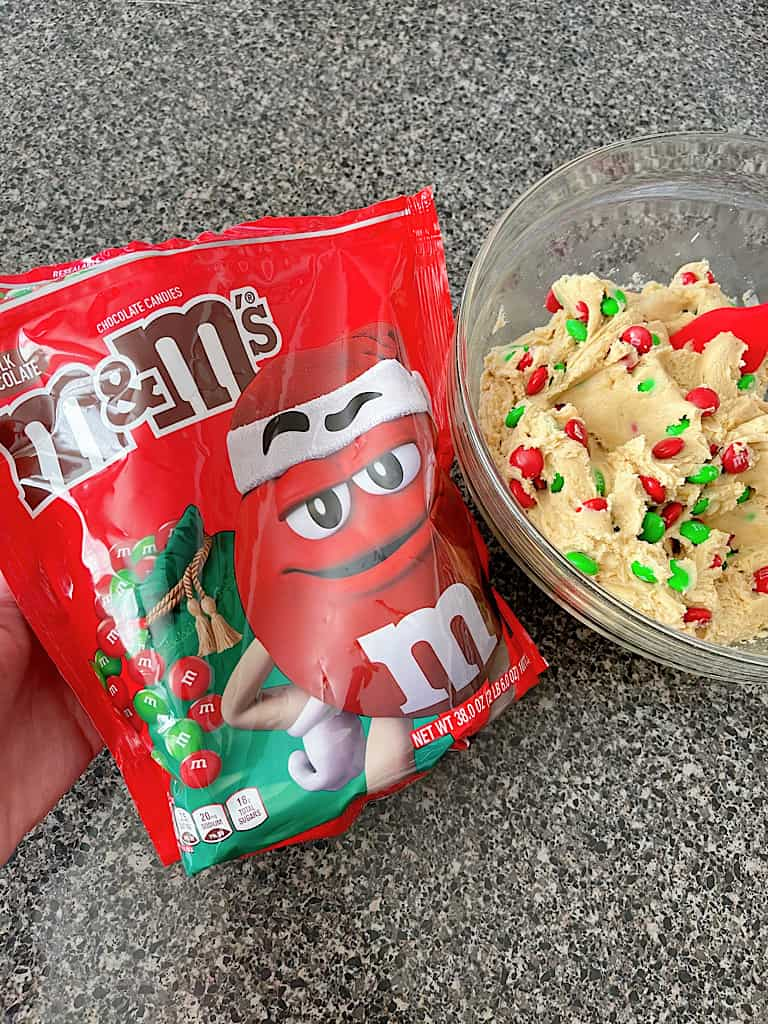 A bag of Christmas M&Ms and cream cheese cookie dough