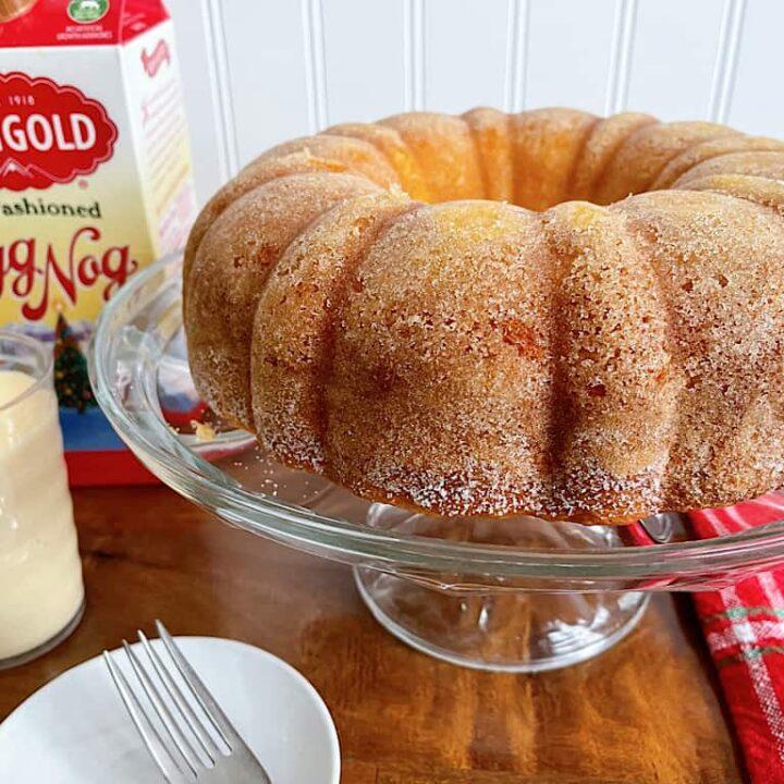 Eggnog bundt cake and a glass of eggnog.