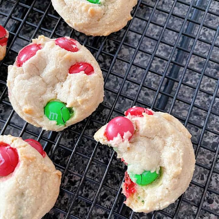 Cream Cheese Cookies with M&Ms on a cooling rack