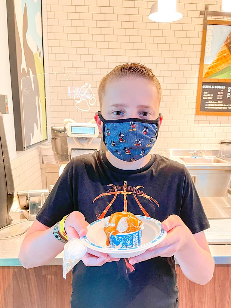 A child wearing a mask at Great Wolf Lodge during COVID