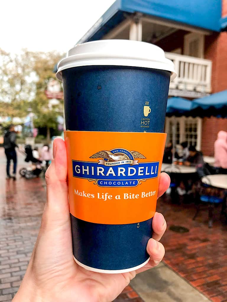 A cup of Ghirardelli Sea Salt Caramel Hot Cocoa