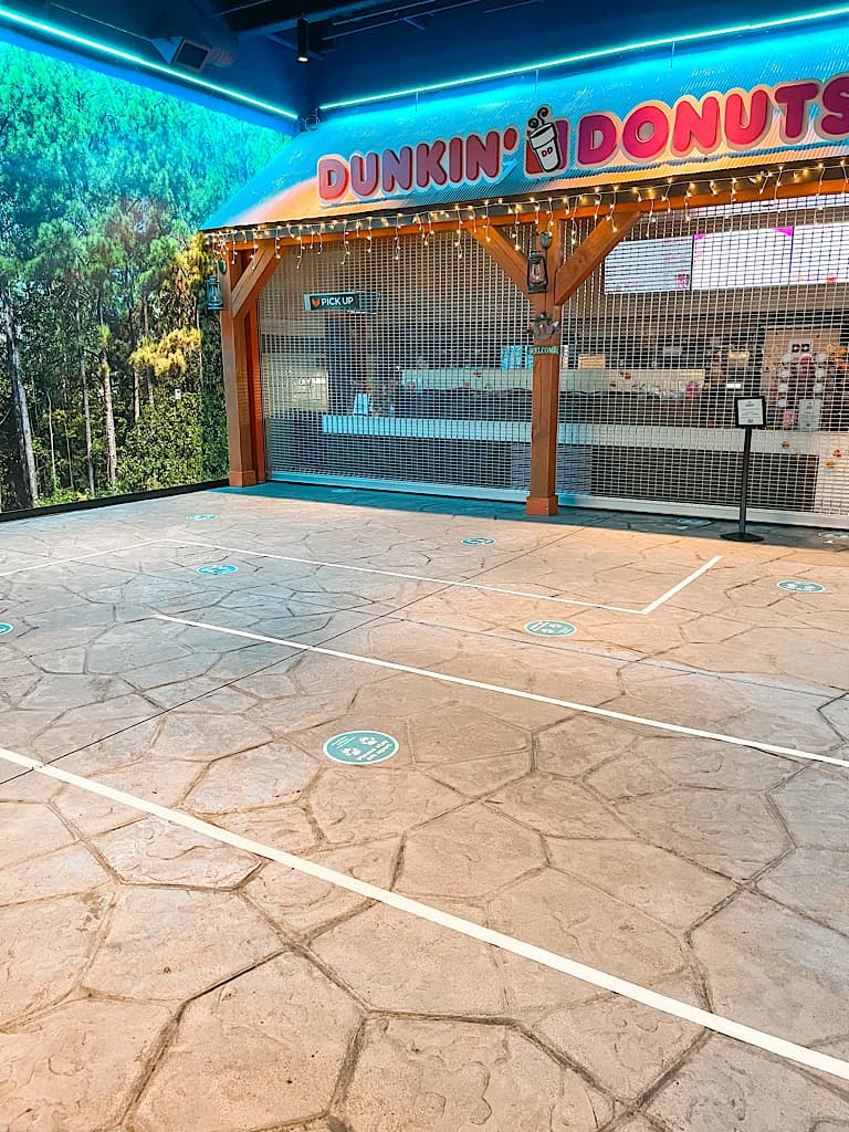 Social distancing markers outside Dunkin Donuts at Great Wolf Lodge