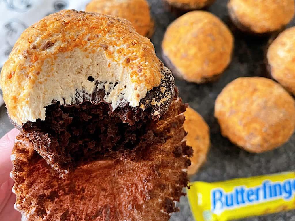 A homemade version of Disney's Peanut Butter Crunch cupcake and a butterfinger candy bar.