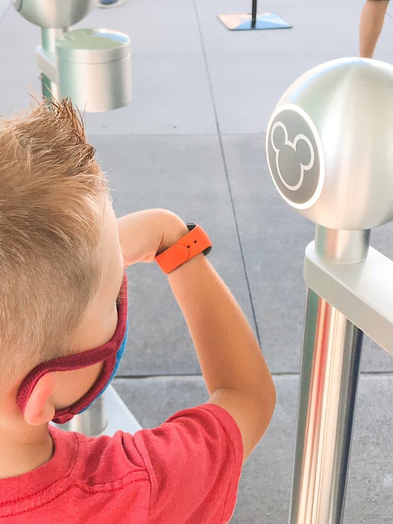 A boy entering Disney's Magic Kingdom Park