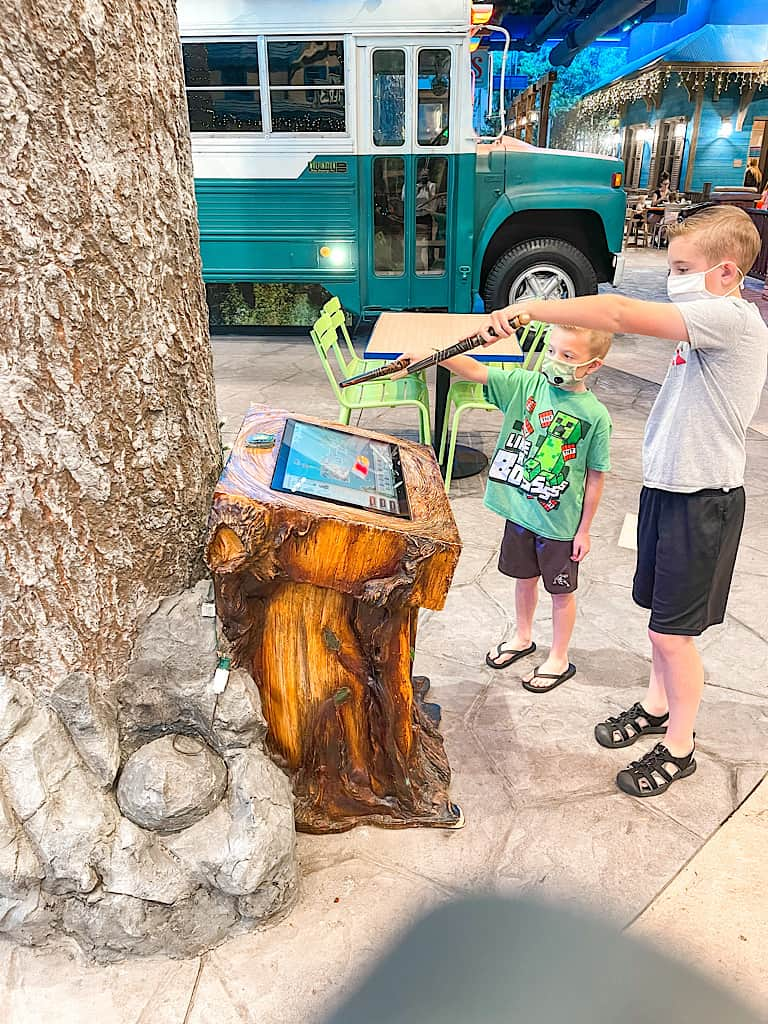 Two Kids standing in front of a MagiQuest kiosk at Great Wolf Lodge