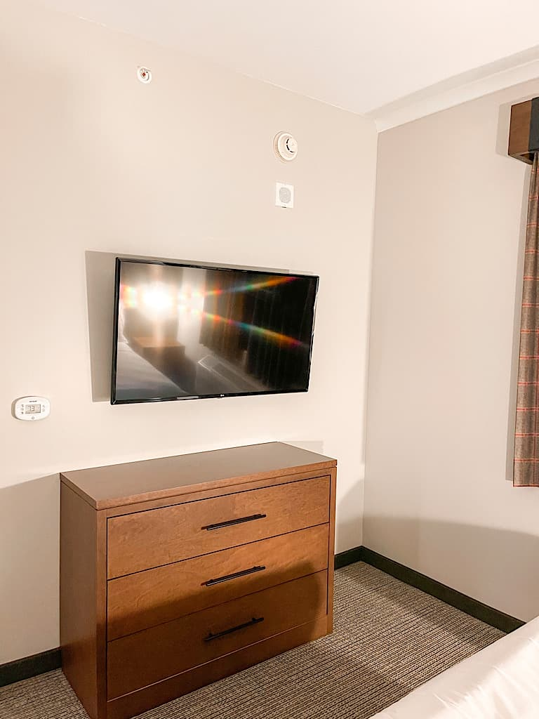 TV and dresser in Bedroom 2 of Grizzly Bear Suite