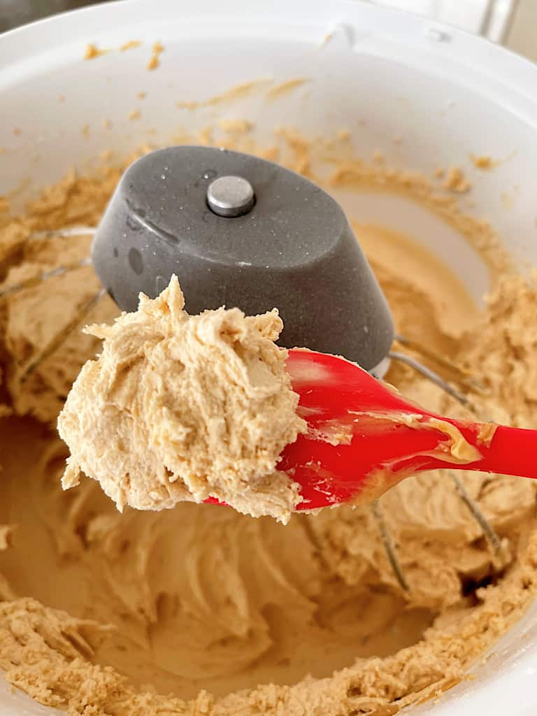 If the frosting is still too thick, add more milk or cream one tablespoon at a time until you reach your desired consistency. Set aside.