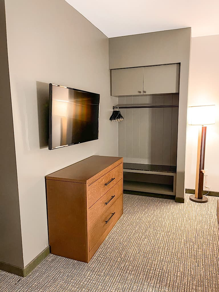Dresser, tv, and storage area in bedroom 1 of Grizzly Bear Suite at Great Wolf Lodge Arizona