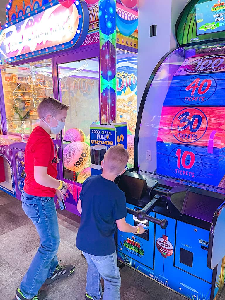 Two kids playing an arcade game at Great Wolf Lodge