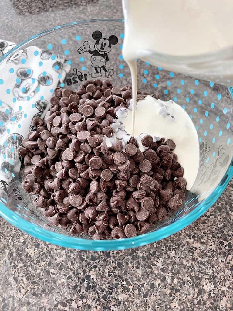 Pour the cream over the top of the chocolate chips.