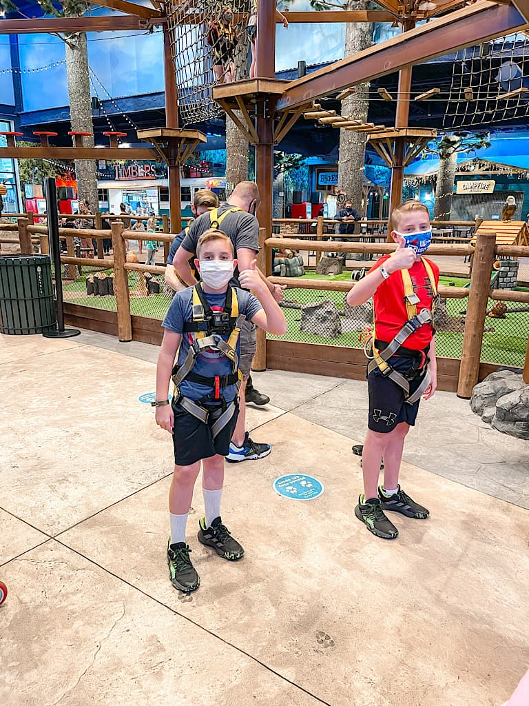 Two young boys in climbing harnesses at Great Wolf Lodge