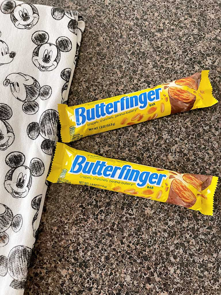 Two Butterfinger candy bars and a Mickey Mouse towel.