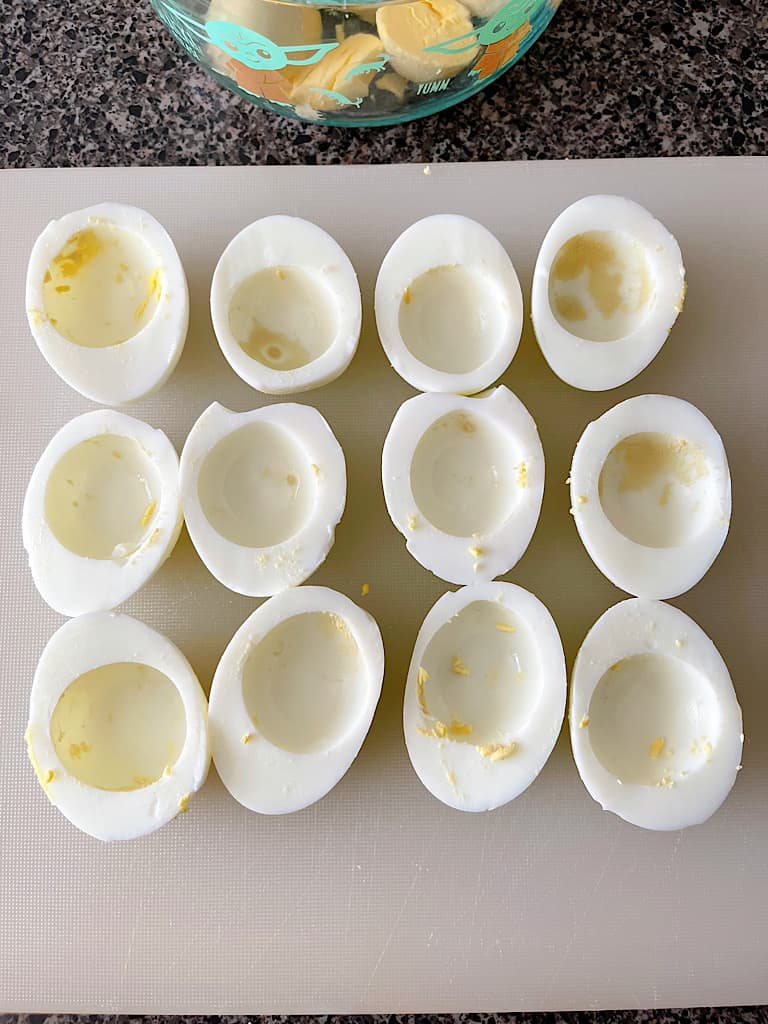 Hard boiled egg whites cut in half with the yolks removed.