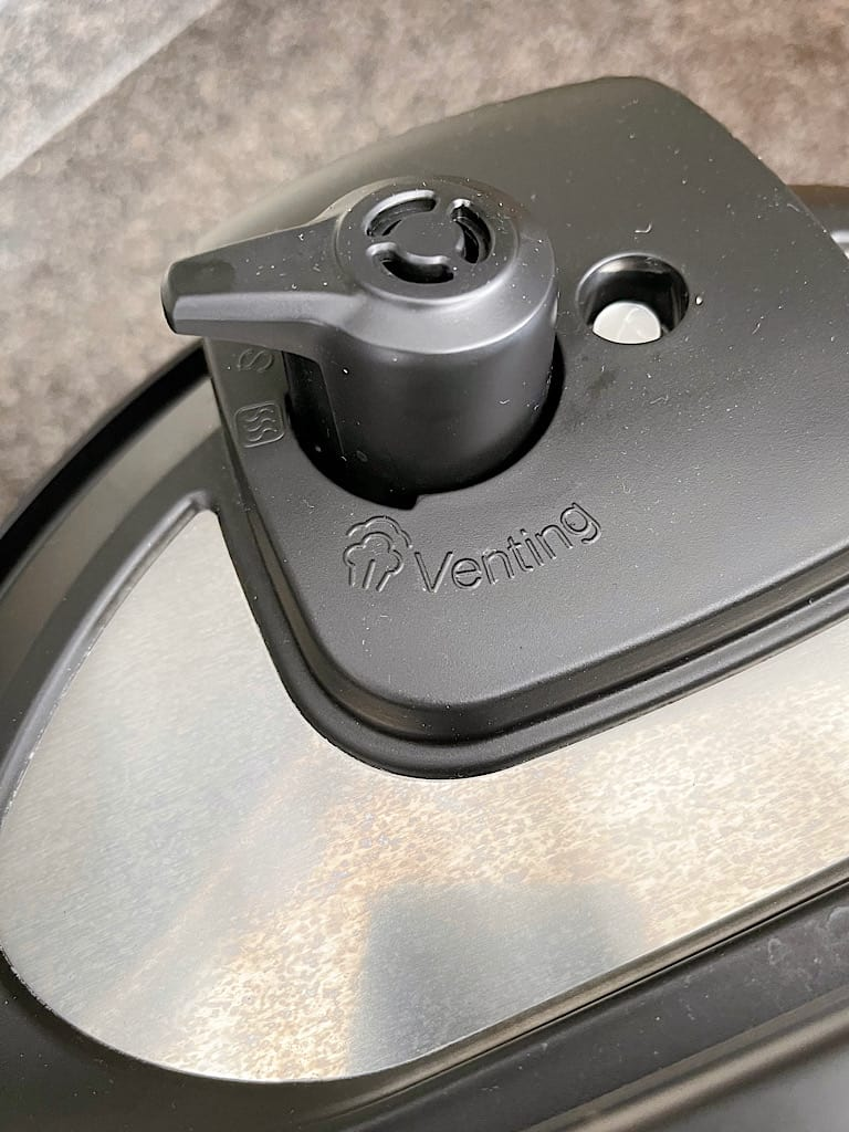 The vent closed on the lid of an Instant Pot.