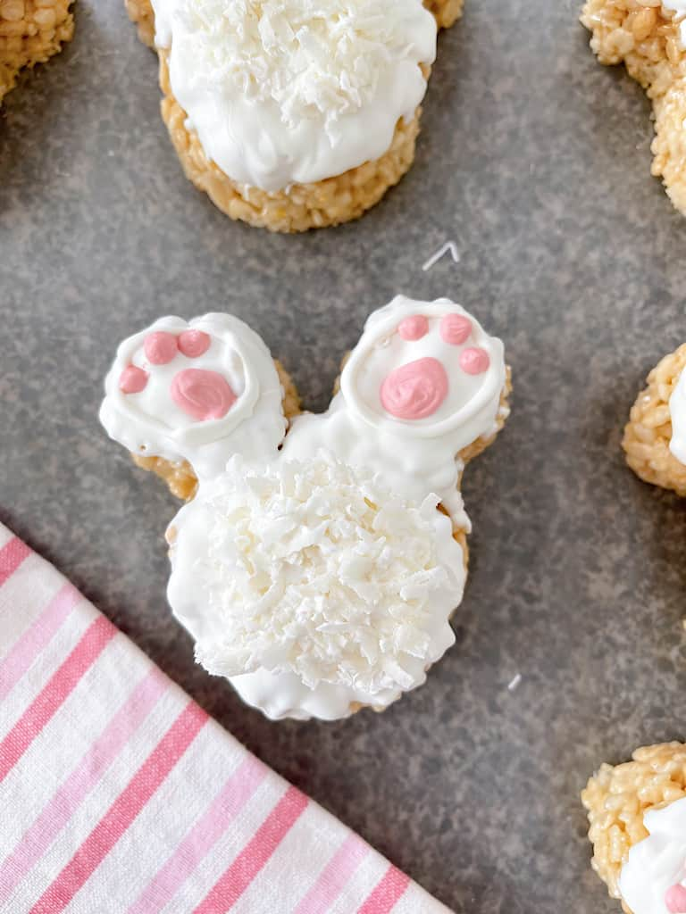 A bunny tail rice Krispie Treat with a pink and white towel.