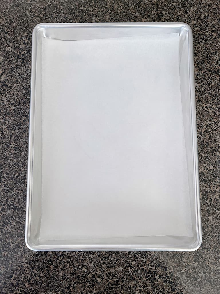 A baking sheet lined with parchment paper.