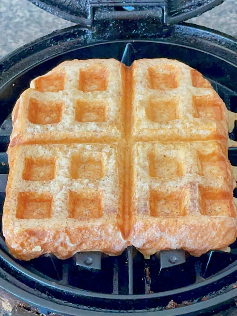 A French Toast waffle on a waffle iron.