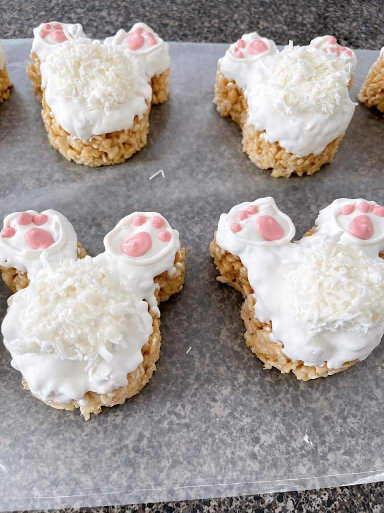 Rice Krispie Treats shaped like Mickey Mouse made to look like bunny tails for Easter.