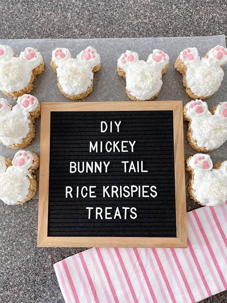 "Bunny tail Rice Krispie Treats around a sign that says, ""DIY Mickey Bunny Tail Rice Krispies Treats."""
