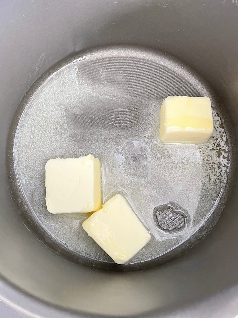 Butter melting in a pan for Rice Krispie Treats.