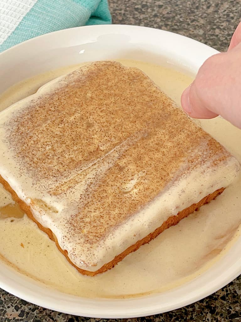 A piece of bread dipped in French Toast batter.
