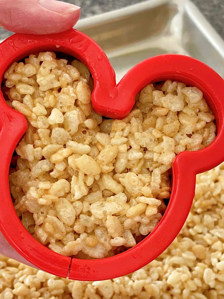 A Mickey Mouse cookie cutter filled with Rice Krispie Treat mixture.