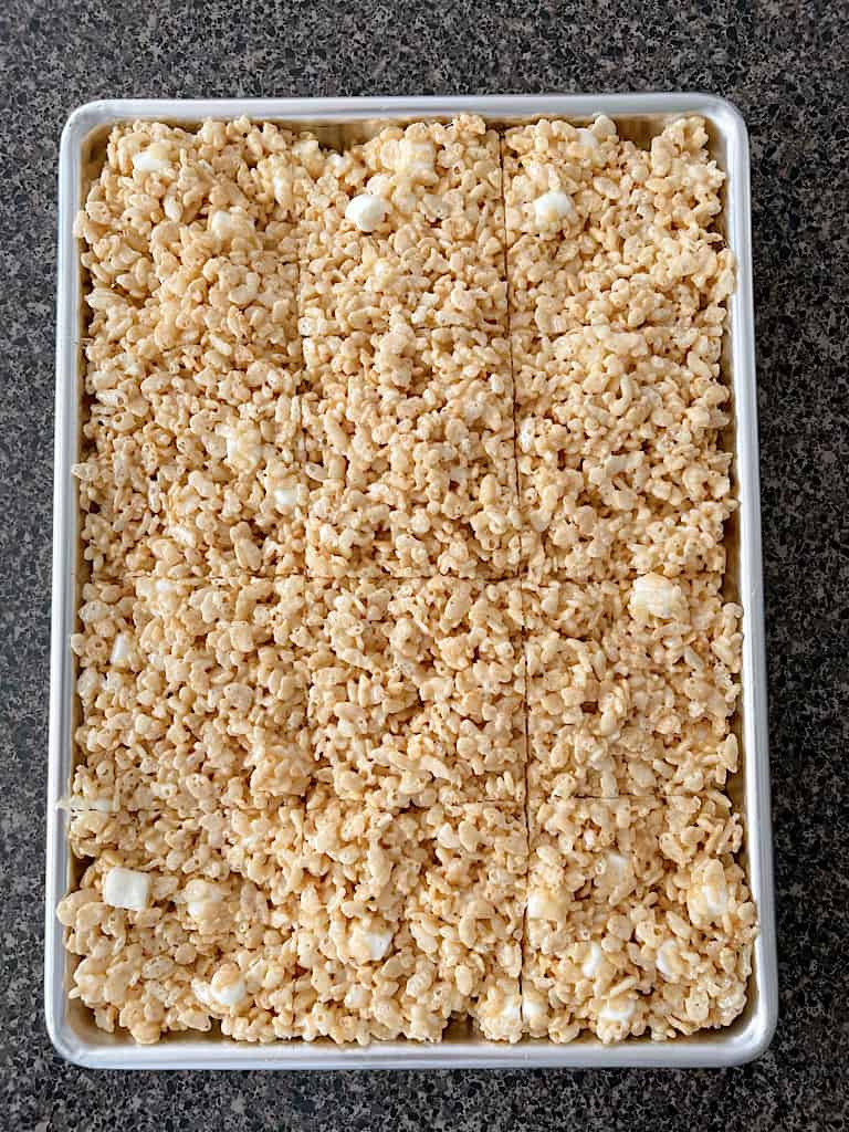 A pan of Rice Krispies Treats cut into squares.