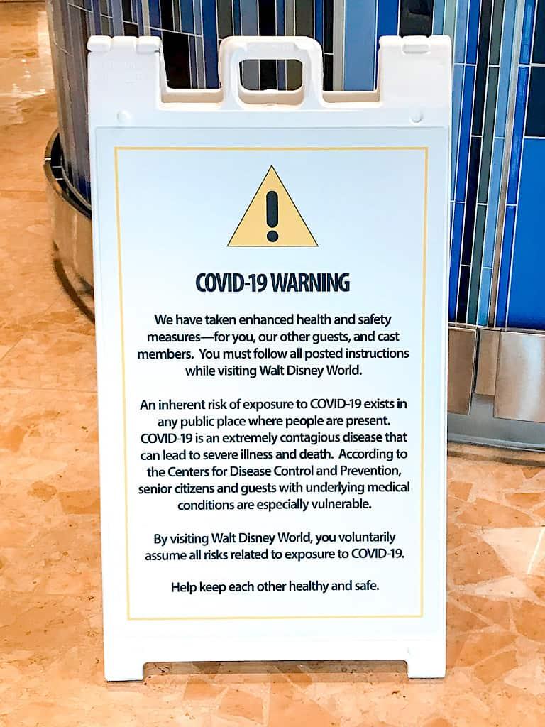 Covid-19 warning sign at Disney World.