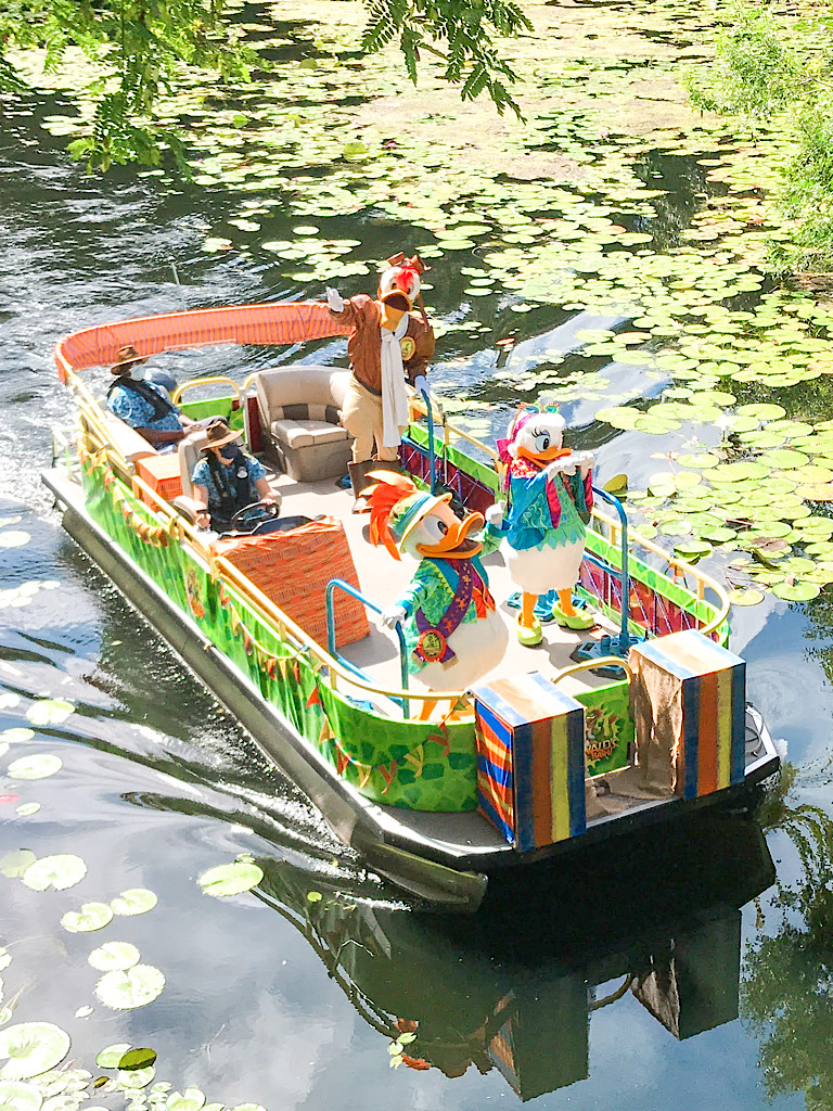 Disney characters on a boat at Animal Kingdom.