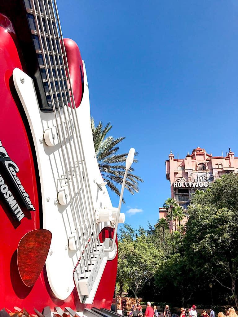 A view of the giant guitar in front of Rock 'n' Roller Coaster and the top of the Tower of Terror at Hollywood Studios.